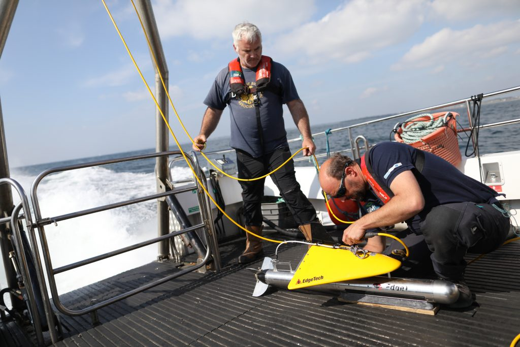 Readying the side-scan sonar towfish for deployment